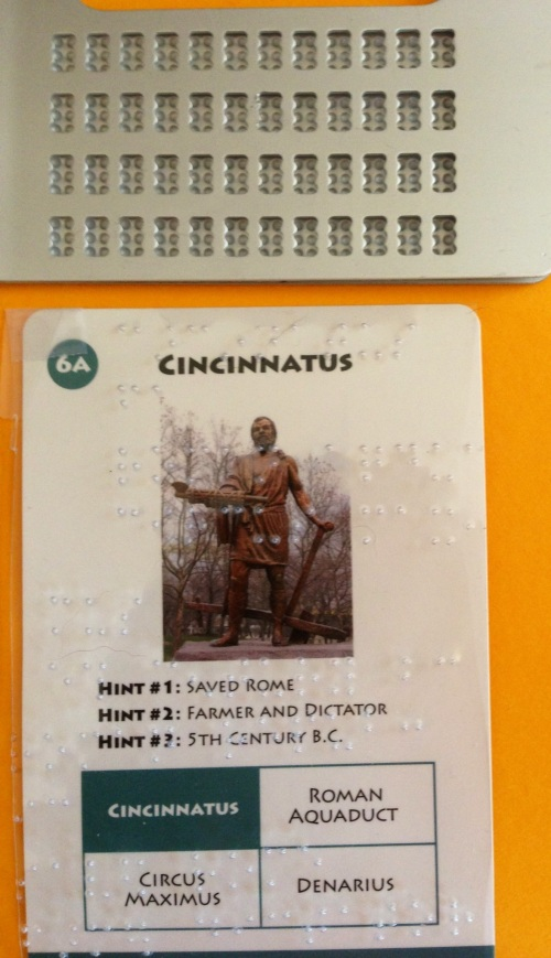 Game card of Cincinnatus overlaid with clear plastic brailled with card information.